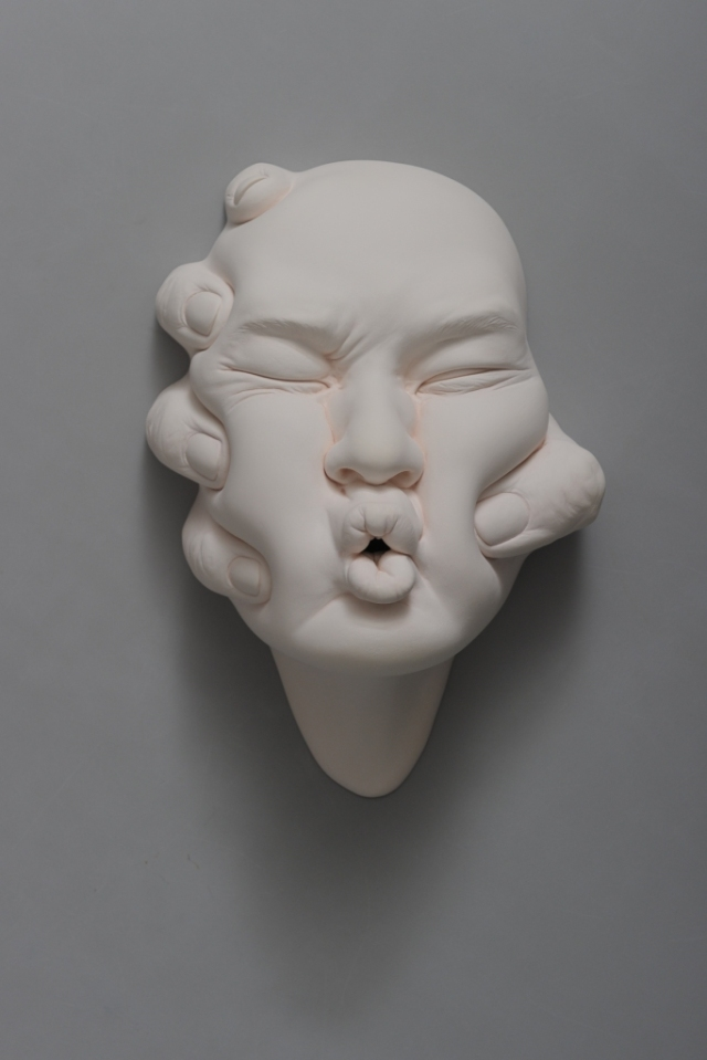 Porcelain Face Sculptures by Johnson Tsang